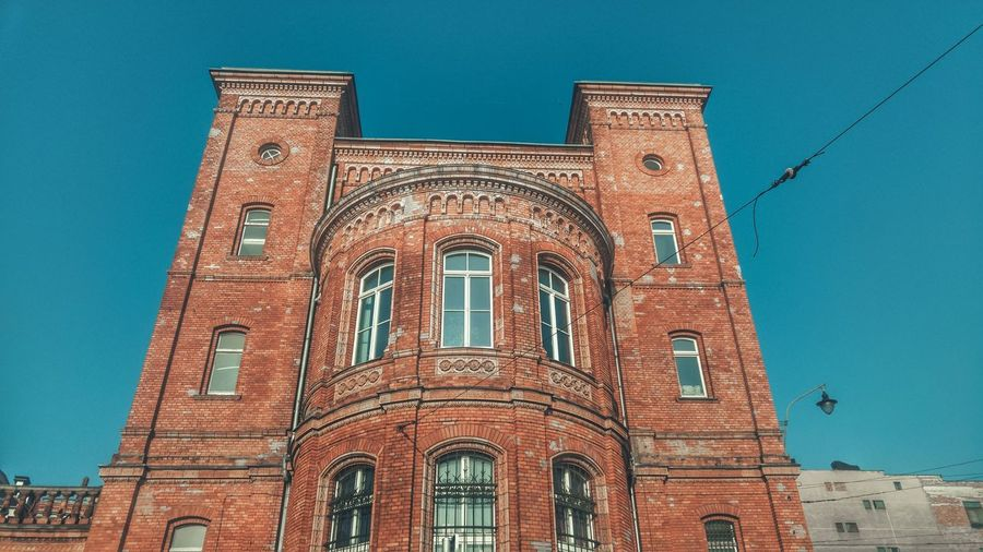 Architecture Building Exterior Low Angle View Blue Built Structure Window No People Clear Sky Sky Day Outdoors Arch Clock Tower Clock Windows Brick Building Brick Wall Red Brick Brick City Szczecin Spacer Po Szczecinie Walking Around Morning Walk