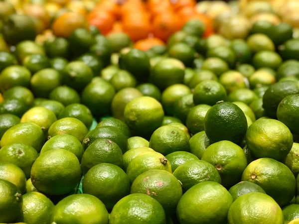 Limes on market Orange Color Lemon Lime Green Lime Food Food And Drink Freshness Healthy Eating Green Color Wellbeing Abundance Fruit Full Frame Large Group Of Objects Citrus Fruit Market Retail  Market Stall Backgrounds No People Organic Close-up For Sale