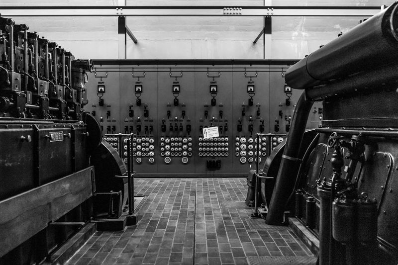 Power station with diesel generators in Swiss cold war military fort. Diesel Generator Cold War Military Museum Militarybase Military No People Architecture Built Structure Indoors  Railing Wall - Building Feature Side By Side First Eyeem Photo