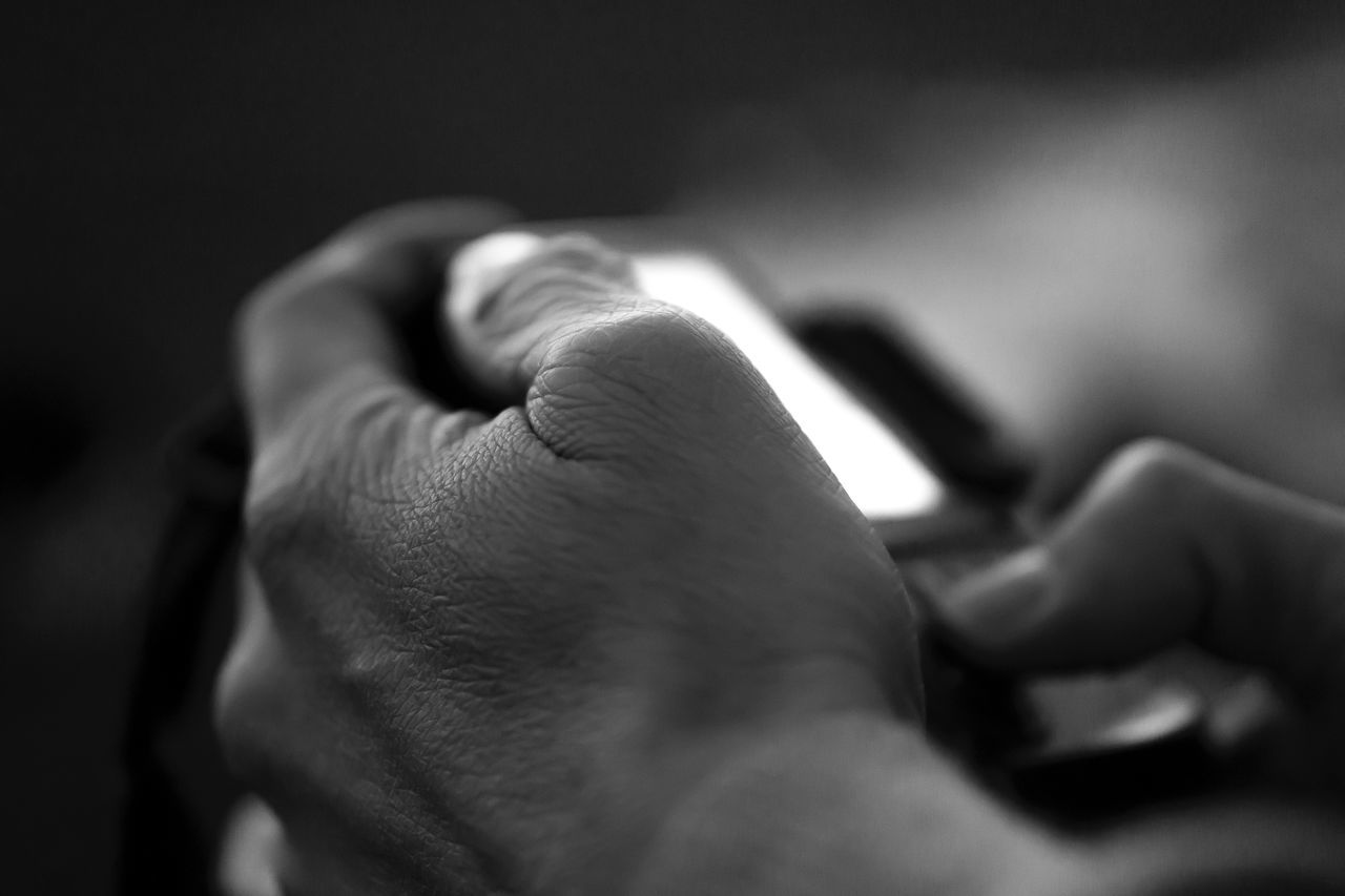 Close-Up Of Hands Using Phone