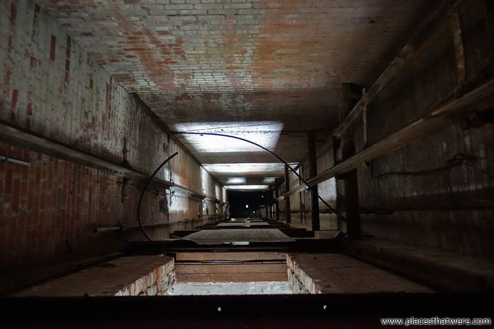 It's a long way down. http://www.placesthatwere.com/2017/12/abandoned-warner-and-swasey-company.html Abandoned Factory Urbex Shaft Creepy Eerie Rust Belt Abandoned Places Abandoned Buildings Abandoned & Derelict Elevator Shaft Decay Brick Wall Long Way Down Abyss Indoors  No People Architecture Day