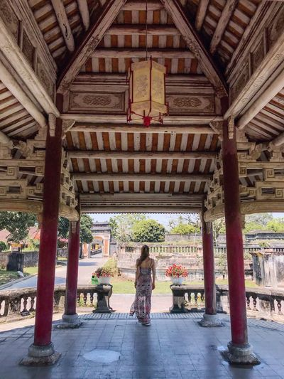 Lantern Woman In Dress Tourist Attraction  Travel Destinations Park - Man Made Space Garden Palace Garden Palace Historical Site Historical Building Vietnam Huế Forbidden City Imperial City Standing Architecture Built Structure Full Length Architectural Column Day Real People Women Building Exterior Indoors  One Person Adult Only Women Adults Only People Young Adult