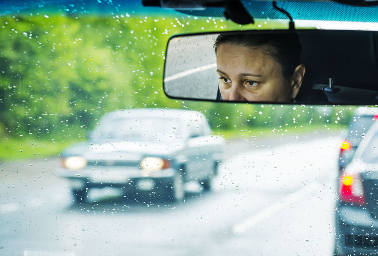 Reflection Of Woman In Car