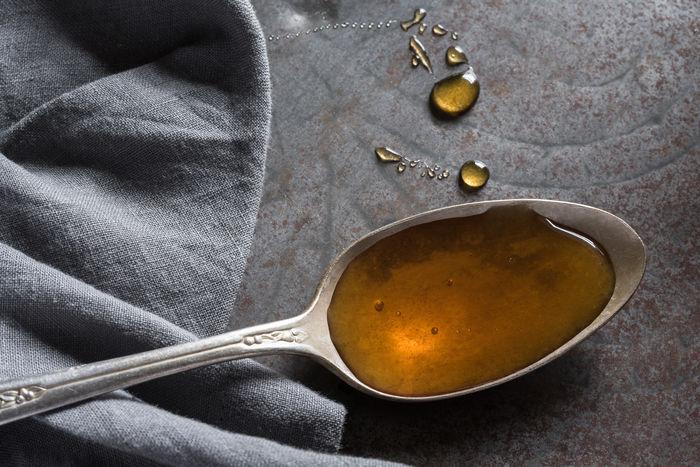 Honey on vintage spoon Isolated Spoon Close-up Food Healthy Eating Honey Ingredient No People Sweet Sweetener Vintage