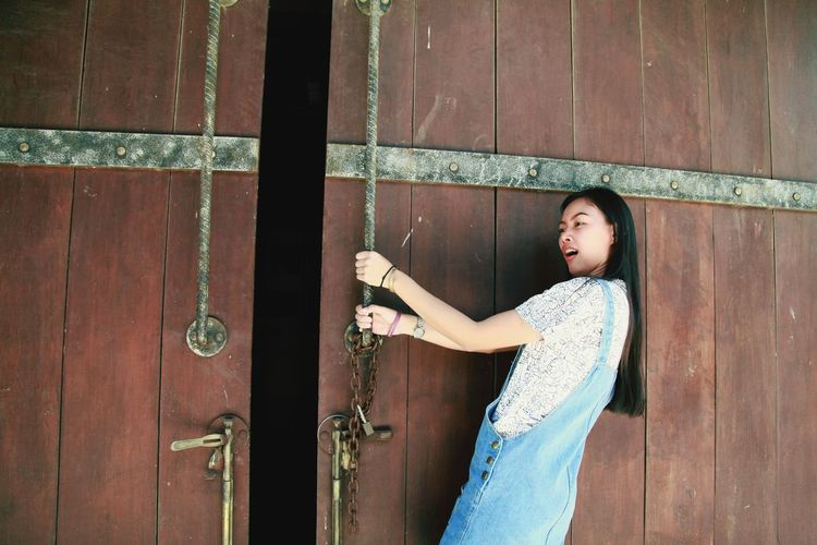 EyeEm Selects Young Women Standing Portrait Women Beautiful People Door Doorknob Front Door Open Door Gate Posing