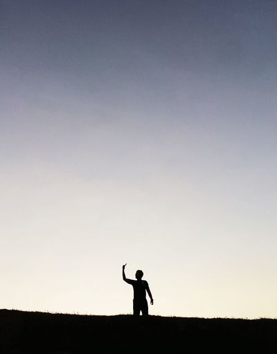 Man standing against clear sky