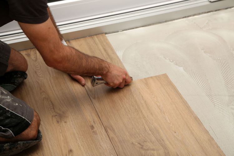 High angle view of man working on wooden flooring