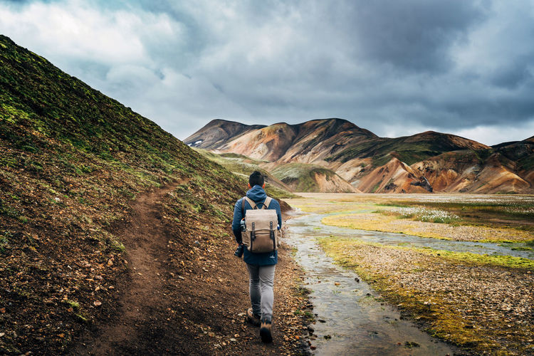 Adult Adults Only Beauty In Nature Cloud - Sky Day Full Length Hiking Iceland Landmannalaugar Landscape Men Mountain Nature One Person Only Men Outdoors People Real People Rear View Scenics Sky Standing Lost In The Landscape Travlr Fresh on Market 2016