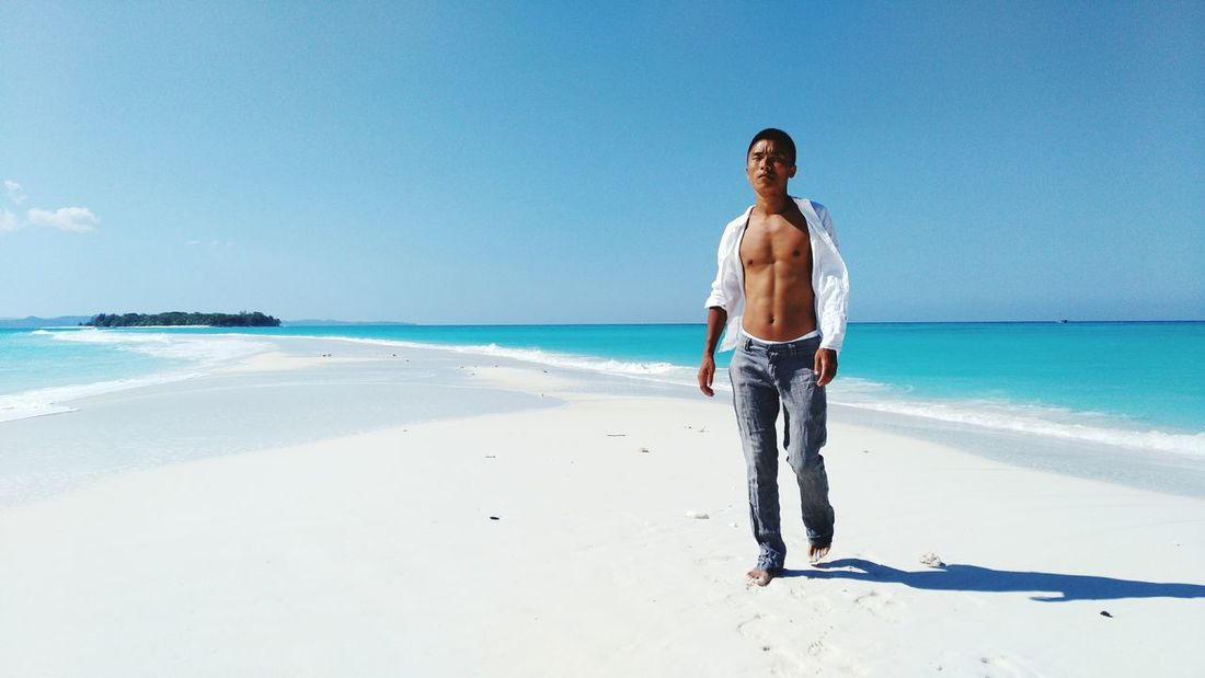 Sea Beach Only Men One Person One Man Only Leisure Activity Vacations Adults Only Horizon Over Water Sand Full Length Travel Destinations Outdoors Day Adult Sky Front View People Young Adult Men