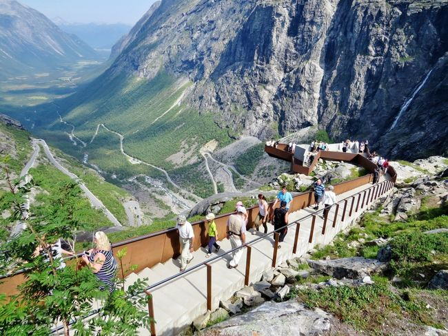 Adventure Beauty In Nature Day Leisure Activity Medium Group Of People Men Mountain Mountain Range Møre Og Romsdal Nature Outdoors People Real People Sky Togetherness Travel Destinations Traveling TripAdvisor Trollstigen View From Above Viewpoint Views Women