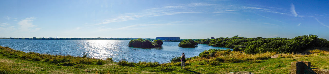 Beauty In Nature Blue Day Grass Green Color Growth Horizon Over Water Idyllic Lake Landscape Nature Panorama Plant Scenics Sea Sky Sunlight Tranquil Scene Tranquility Tree Water