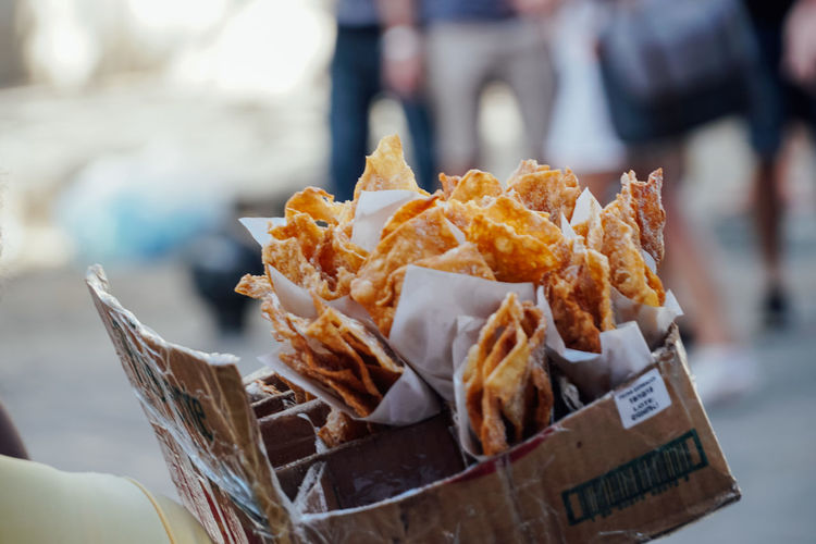 Close-up of nacho chips in box at market for sale