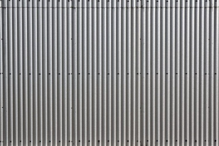 Corrugated rolled steel industrial background Architecture Industrial Abstract Aluminum Backgrounds Brushed Metal Close-up Corrugated Iron Day Detail Gray Metal No People Outdoors Pattern Rivets Shutter Silver - Metal Silver Colored Steel Steel Structure  Textured  Vertical Lines Wall - Building Feature