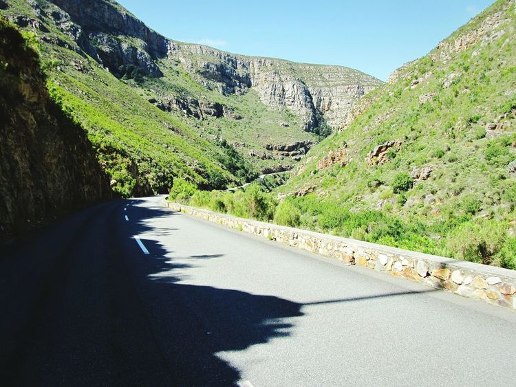 Traveling Forward ~ Mountain Mountain Range Mountain Pass Paved Road Curving Road Cape Province South Africa Between The Lines Shadows & Lights Stones Wall Retaining Wall Drive Safely Mountain Sunlight Day Outdoors Shadow Road Nature Grass Landscape Beauty In Nature Sky