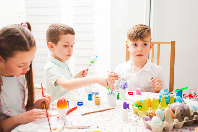 Cute kids painting at home