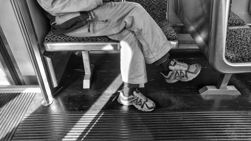 Blackandwhite Monochrome Morningcomute Train Morning Low Section Human Leg Real People One Person Indoors  Lifestyles Day Sitting People Human Body Part