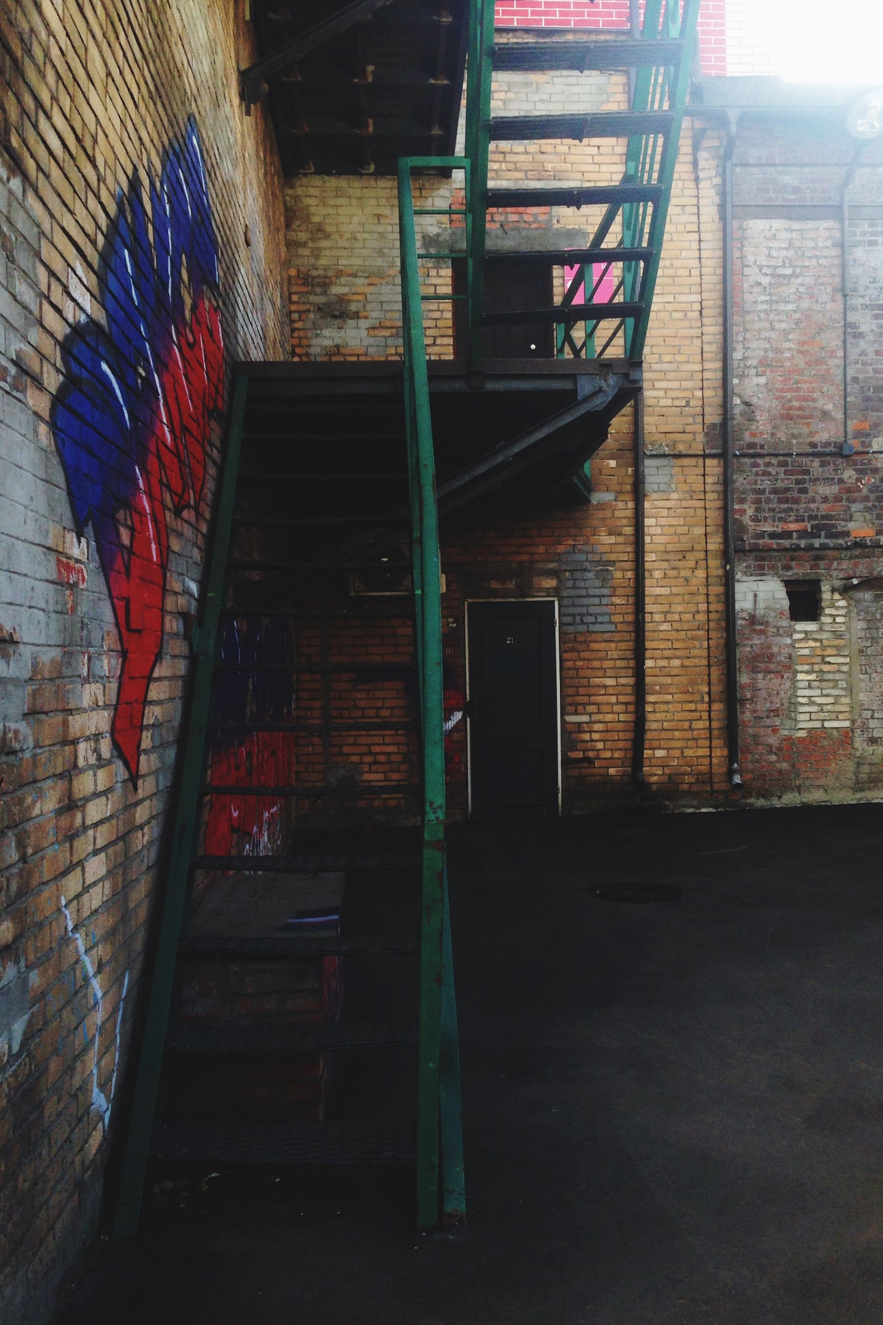 architecture, built structure, building exterior, door, house, brick wall, steps, wall - building feature, building, closed, window, graffiti, indoors, entrance, staircase, steps and staircases, abandoned, residential structure, wood - material, wall