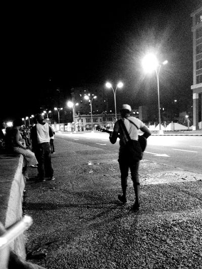 Alone in the street with my music Black & White Casual Clothing City City Life Illuminated La Habana Lifestyles Musician Night Outdoors Street Light Street Musician