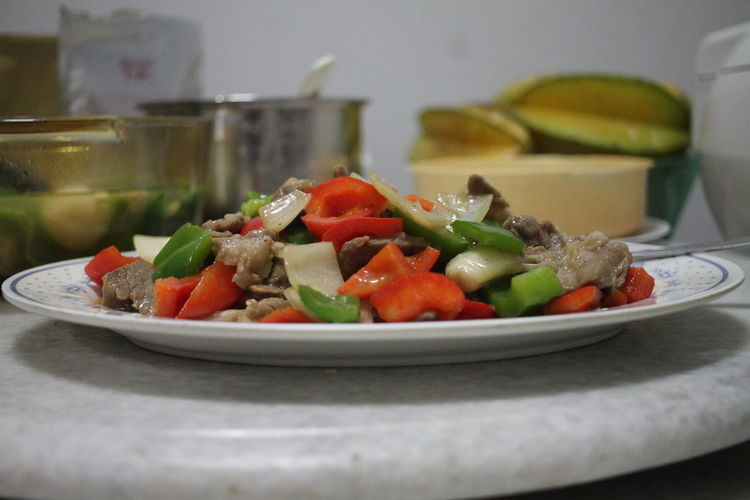 Close-up of chopped vegetables in plate on table