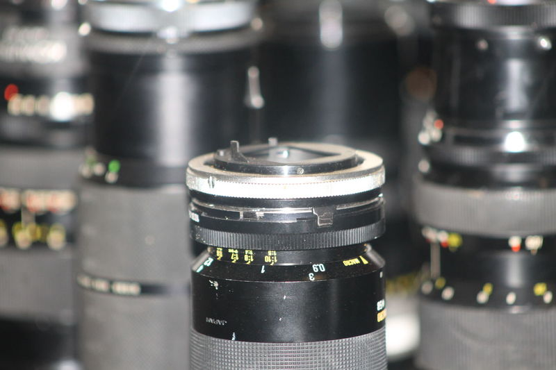 Photography Themes Technology Lens - Optical Instrument Close-up Indoors  Camera - Photographic Equipment Photographic Equipment No People Focus On Foreground Equipment Camera Selective Focus Lens - Eye Still Life Modern Table Digital Camera Metal Black Color Industry Silver Colored