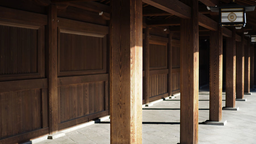 Shinjuku, Japan. 17th March 2018. Meiji-jingu Shrine. A Shinto Japanese temple poles with beautiful sunlight and shadow. Architecture Wood - Material Building Built Structure Indoors  No People Day Architectural Column Absence Sunlight Ceiling Pattern Arcade In A Row Wood Door Brown Entrance Corridor Roof Beam Colonnade Shinto Shrine Shinto Temple Eyeemtravel  Japan