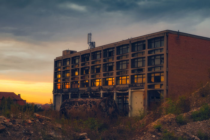 Sunset reflected in the broken windows of the abandoned industrial building Abandoned & Derelict Abandoned Places Broken Window Cloudy Sky Dark Sky EyeEmNewHere Industrial Building  Industry Reflection Abandonado Abandonat Abandoned Architecture Bridge - Man Made Structure Building Building Exterior Built Structure Cloud - Sky Damaged Day Factory Industry Land Low Angle View Nature No People Obsolete Outdoors Plant Puesta Del Sol Roberto Sorin Sky Sunset Sunset #sun #clouds #skylovers #sky #nature #beautifulinnature #naturalbeauty #photography #landscape