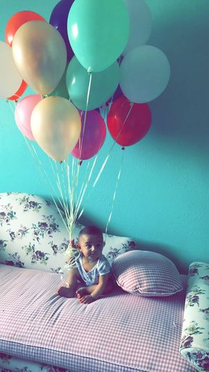 Portrait Of Happy Baby Boy With Balloons