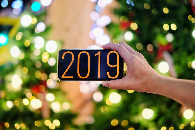 Happy New Years 2019 New Year Human Hand Tree Defocused Christmas Decoration Illuminated Christmas Present Gift Christmas Lights Christmas Holiday - Event Christmas Stocking Decorating The Christmas Tree christmas tree Long Shadow - Shadow Santa Hat Christmas Ornament Candy Cane Christmas Market Pine Tree Santa Claus