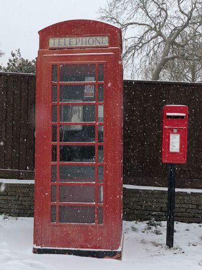 Telephone box in the snow! EyeEm Gallery Eyeemphotography EyeEm Selects EyeEm Best Shots EyeEm London Snow Winter Red Cold Temperature Communication Weather Telephone Booth Day Tree No People Outdoors Pay Phone Nature Bare Tree Snowing Sky Close-up