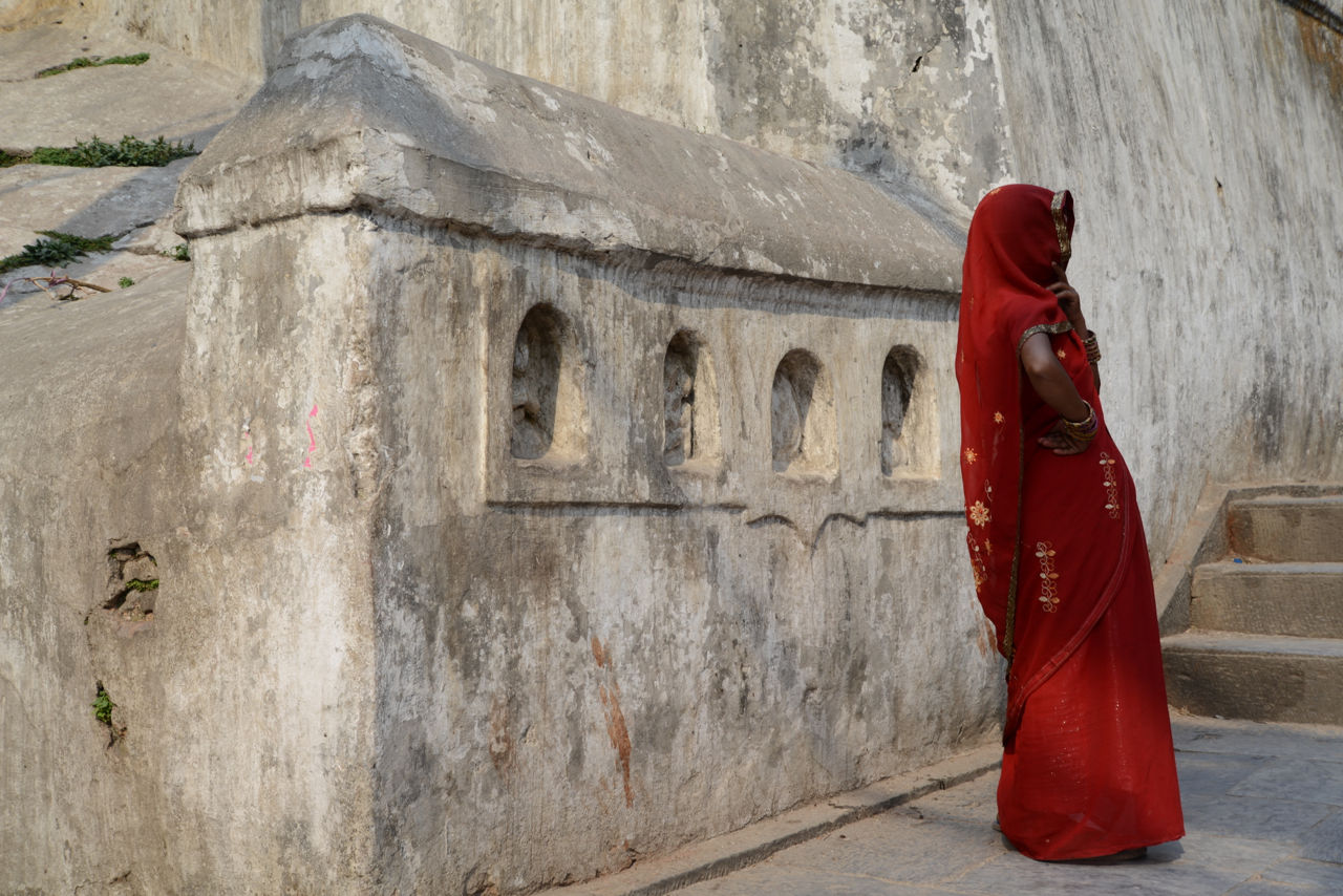 red, outdoors, day, religion, built structure, women, architecture, real people, one person, people