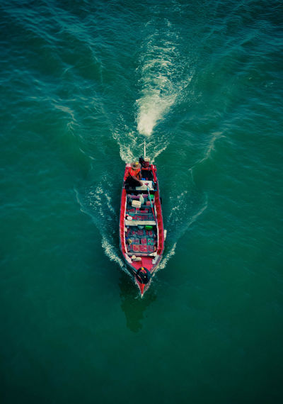 Lifestyle. Water Sea High Angle View Nautical Vessel Motion Transportation Day Nature Mode Of Transportation Sport Outdoors Wave Pattern Waterfront Wake - Water Directly Above Adventure Real People Red Ship Lifestyles Fisherman Happiness