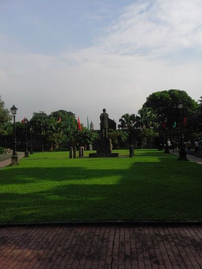 Intramuros| Philippines Jose Rizal Monument PHL History Philippines Rizal Beauty In Nature Cloud - Sky Day Grass Green Color Growth Intramuros Memorial Outdoors Pilipinas Sky Travel Destinations Tree