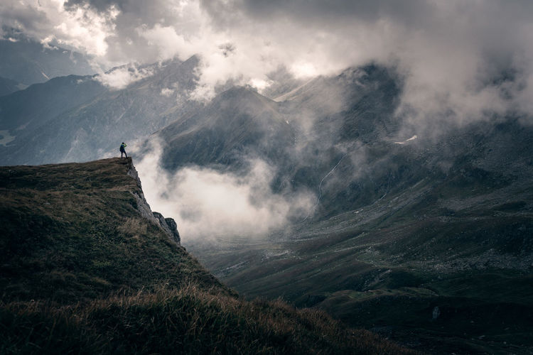 People are so small compared to nature, yet we have such a huge impact... Alps Austria Austrian Alps Cloudscape Cloudy Moody Sky Moody One Person Scale  View Exploring Cloud - Sky Mountain Beauty In Nature Mountain Range Non-urban Scene Outdoors Hiking Adventure Enjoying The View