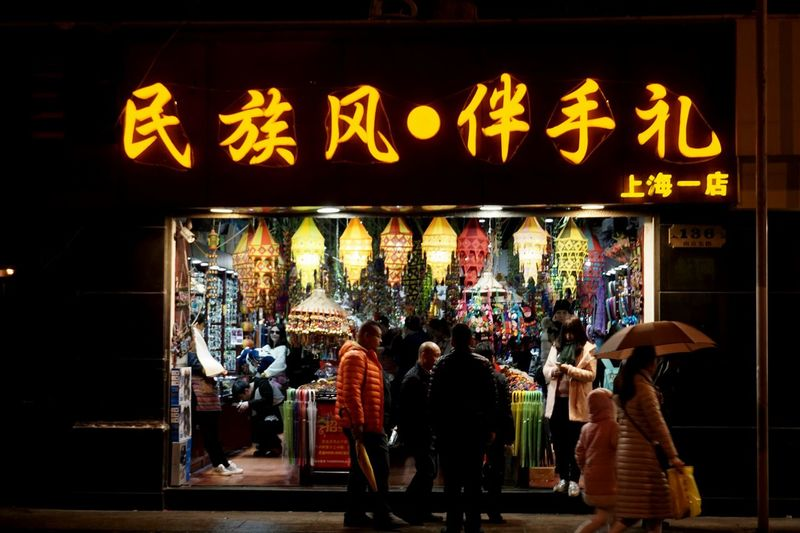 Night Photography Chinese Style People Walking  Night Dark Hidden Gems  People Together Chinese People At The Street Chinese My Shanghai Chinese Culture Showcase July 43 Golden Moments Store Chinese Letters Coats at Shanghai, China Miles Away Business Stories