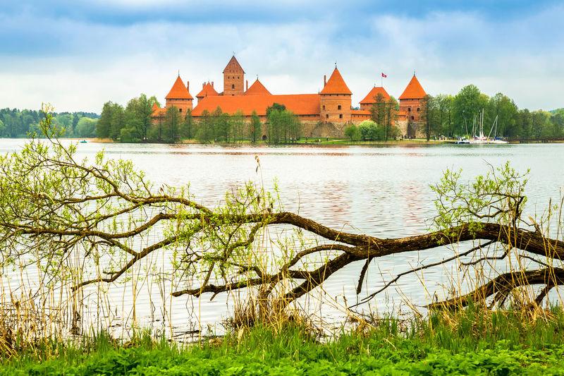 Trakai island castle amidst lake galve against sky
