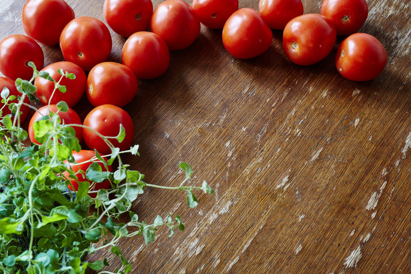 High angle view of cherry tomatoes on table