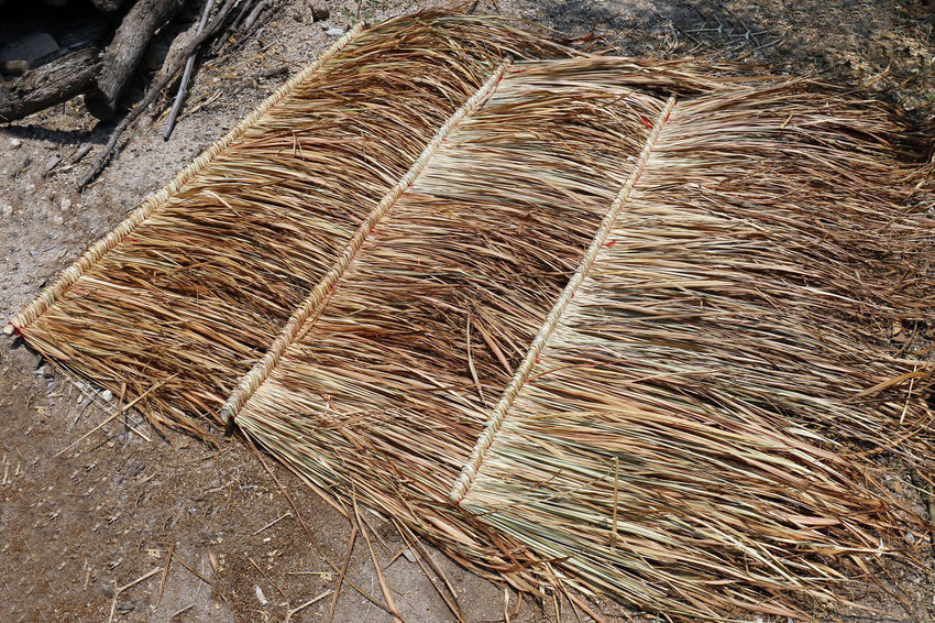 panel of vetiver for hut roof, straw roof on ground, straw roof hut panel Agriculture Broom Brown Close-up Day Dry Grass Hay High Angle View Hut Roof Hut Roof House Large Group Of Objects Nature No People Outdoors Panel Of Vetiver Pattern Plant Still Life Textured  Tree Trunk Twig Vetiver Wood - Material