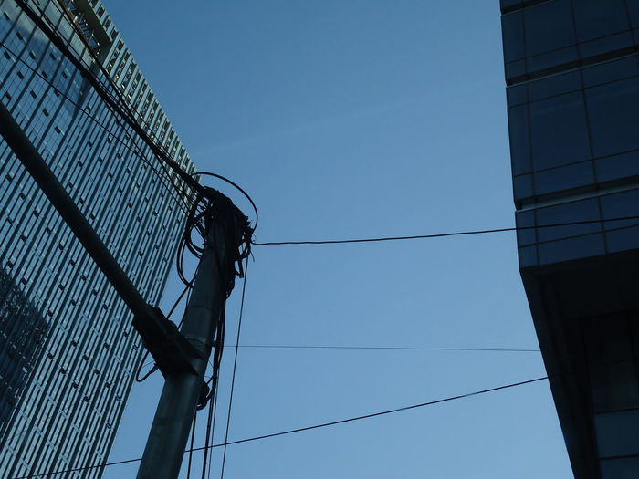 Architecture Blue Building Exterior Built Structure Cable City Clear Sky Connection Day Low Angle View Modern No People Outdoors Sky Skyscraper Urban