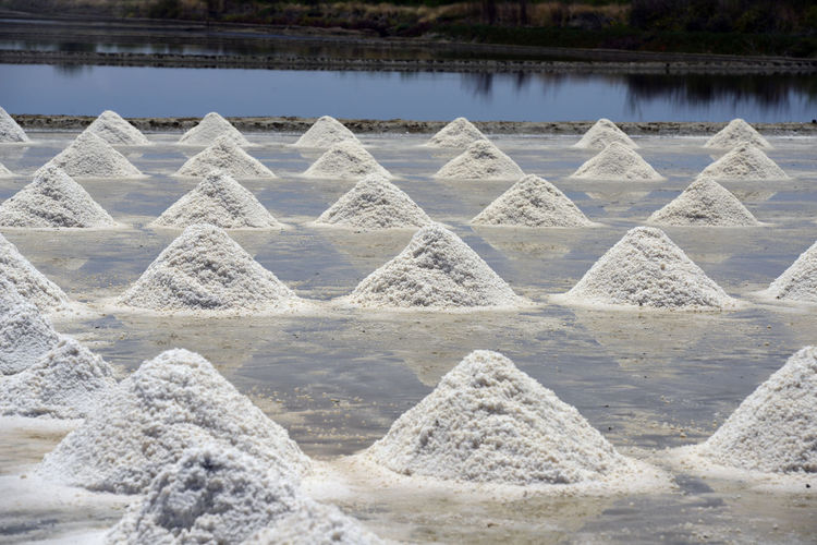 Salt Heaps With Reflection On Water