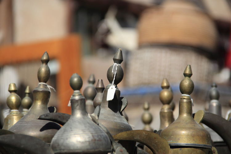 Close-Up Of Antique Coffee Pots With Labels At Souq Waqif