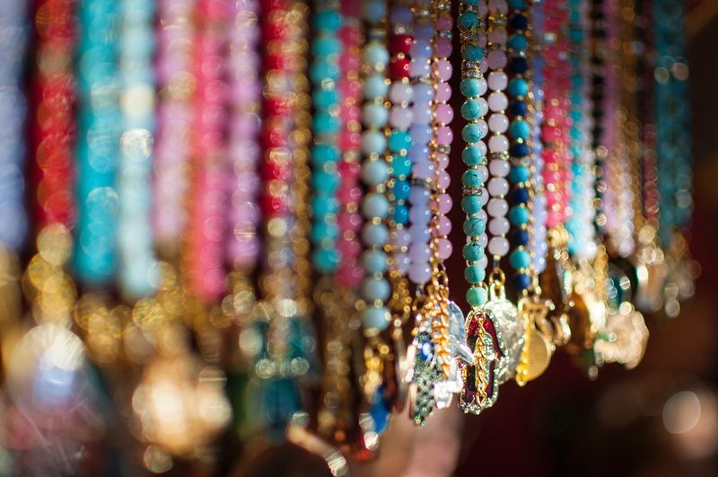 Colorful Beads Hanging At Market For Sale