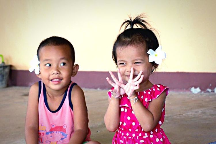 boy and girl are playing Childhood Child Portrait Looking At Camera Waist Up Cute Front View Happiness Playing Children Only Smiling Togetherness TWOKIDS Playtogether Funnytime