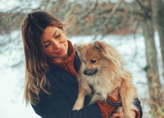 Woman with dog during winter