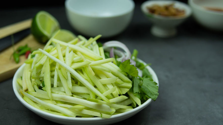 High angle view of chopped vegetables in bowl on table