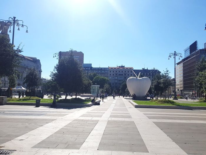 View of city street against blue sky