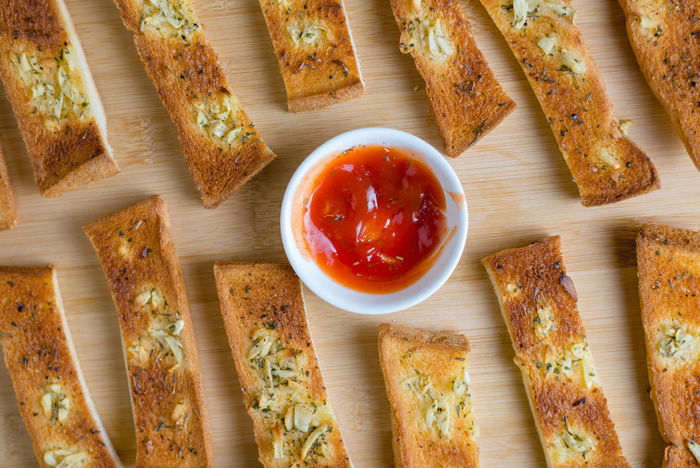 DIP Baked Baked Pastry Item Bread Bread Sticks  Cutting Board Day DIP Directly Above Food Food And Drink Freshness Garlic Bread Indoors  Italian Food Ketchup No People Ready-to-eat Spread Table Toasted Bread