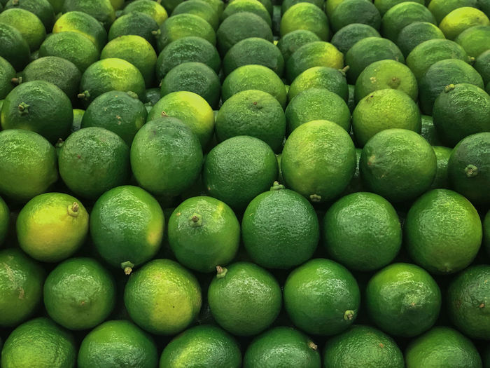Limes on market Green Color Large Group Of Objects Healthy Eating Full Frame Backgrounds Freshness Food Wellbeing Abundance Fruit Indoors  Arrangement Retail  Repetition For Sale Citrus Fruit Lime Limes Green Limes Market Lemons