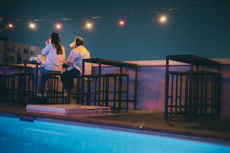 Two woman friend relax in night club at terrace and roof top of restaurant