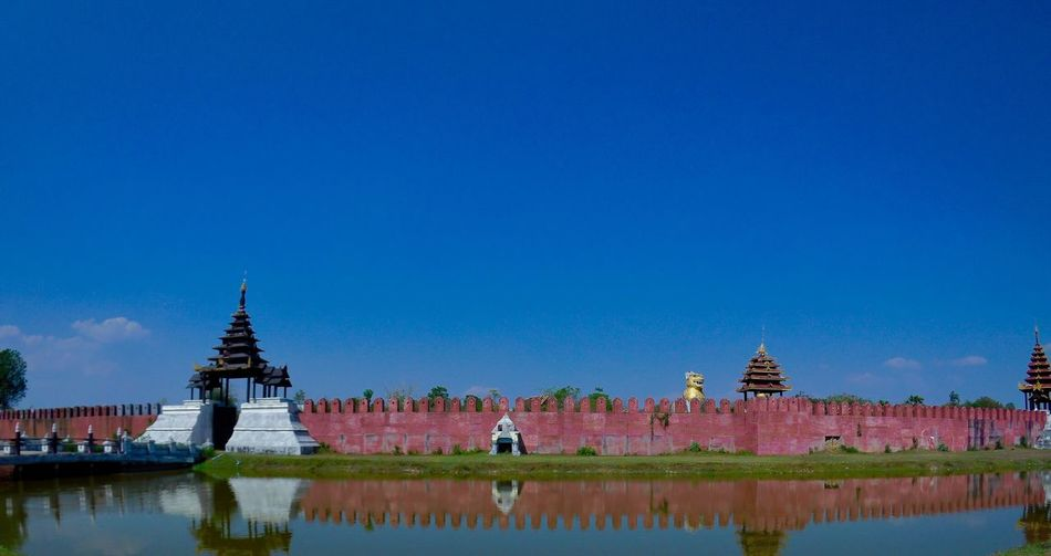 Religion Architecture Place Of Worship History Spirituality Pagoda Travel Destinations Ancient Blue Day Built Structure Building Exterior Sky Travel Tourism Outdoors Clear Sky Water Statue No People