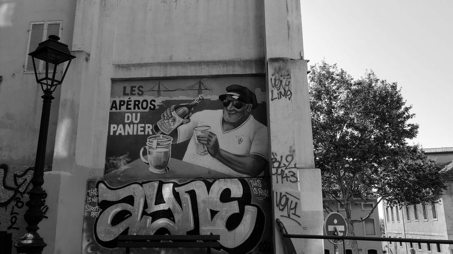 Le panier Summer Summertime Alcohol Alcoholic Drink Aperitif Pastís Short Drink Street Streetphotography Street Photography Streetphoto Marseille Advertisement Advertising Blackandwhite Black And White Black & White Blackandwhite Photography Bnw Bnw_collection Bw Bw_collection Monochorme Communication Text Architecture Close-up Built Structure Building Exterior Street Scene